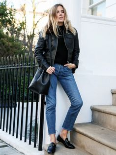 A black top is paired with a cropped leather jacket, cropped jeans, Gucci loafers, and a bucket bag