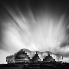 The Sage Gateshead  Music & Art Gallery by Foster + partners:  This is an example of how the architect can use parametric computer programs to create unique designs based off of curving forms.  When these types of buildings are inserted into the context of an old city are they enhancing or detracting from the overall urban context?