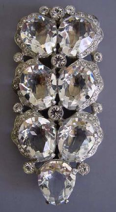 This Eisenberg fur clip, circa 1940, features graduated round clear rhinestones set in silver tone.