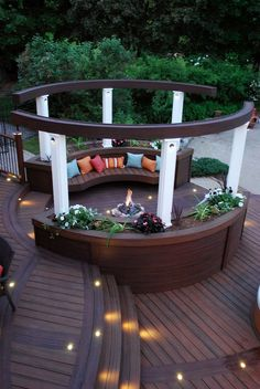 """Dramatic curved aerial beams define the space around the fire pit lounge while keeping an open-air feel. From """"Decked Out"""" project """"The Roundabout Deck"""". Deck Design by Paul Lafrance Design Cozy Backyard, Backyard Seating, Outdoor Seating Areas, Fire Pit Backyard, Backyard Landscaping, Backyard Ideas, Firepit Ideas, Landscaping Design, Diy Pergola"""