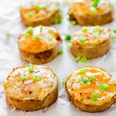 Twice Baked Potato Slices - baked potato slices filled with a mixture of mashed potatoes, bacon and cheese. Perfect appetizer or side dish.