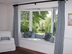 :: for my future house :: Bay Window Seat with Pillows- always wanted a living room with a window like this