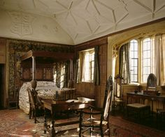 View of Great Chamber with large oak bed with panelled tester, one of the earliest examples of an enriched plaster ceiling, coved and ribbed...