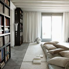 The article is geared towards choosing the right shade of grey, but this room stood out (loving the carpet and pillows and want a room specifically for this!)