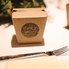 Dessert to go please! Send guests home with a sweet treat. This couple packaged custom-made fortune cookie favors in takeout boxes stamped with their wedding monogram. Photo: Thien Lai of Captus Photography