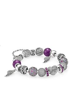 Highly regarded by the ruling classes, purple has traditionally been the color of royalty. Style purple hues with detailed feather charms for an elegant and feminine expression that will bring a sense of refinement to your wardrobe. #PANDORA #PANDORAbracelet
