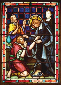 Life of St. John Baptiste de la Salle in stained glass, Saint Mary's College Chapel.  Here de la Salle visits the Bastille prison.  He is here to lift up the prisoner's spiritual lives.