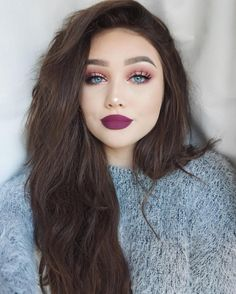 pink eye shadow and burgundy lip