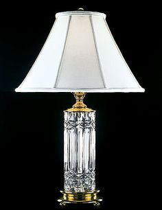 """Waterford Book Of Kells 30"""" Lamp $650.00 H: 30"""" Item# 1029473000 White Starlite Shade, 7x19x13"""" Polished Brass Finish 100 Watt Maximum Bulb, Three-Way Socket, Base 7.25"""" Diameter. All Waterford Crystal Lamps are made to order. The delivery can range from a couple days to a few weeks depending on the piece. You will be notified upon placing the order of estimated time of delivery via email."""