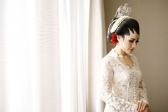 The bride in kebaya wedding dress | Wedding Shot List: Bride Moments to Remember | http://www.bridestory.com/blog/wedding-shot-list-bride-moments-to-remember