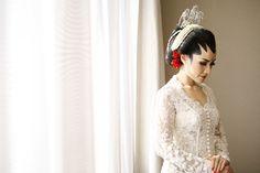 The bride in kebaya wedding dress | Wedding Shot List: Bride Moments to Remember | http://www.bridestory.com/blog/wedding-shot-list-bride-moments-to-remember