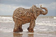 South African artist Andries Botha has constructed some incredible elephant sculptures made of driftwood and layers of wooden plates bolted down to metallic skeletons.