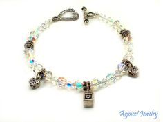 """""""Naomi"""" Lovely  8 inch Hand-Beaded Bracelet with Sterling Silver Christian Charms. www.rejoicejewelry.com  $52"""