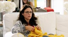 Actress Julia Louis-Dreyfus (aka. Elaine from Seinfeld) in the movie 'Enough Said' knitting a blanket