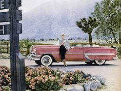 Pink 1954 Chevrolet Convertible and lady