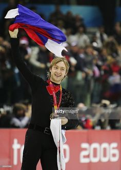 Evgeni Plushenko of Russia waves to the crowd after winning the gold medal in Men's Figure Skating following the Men's Free Skate Program Final during Day 6 of the Turin 2006 Winter Olympic Games on February 16, 2006 at the Palavela in Turin, Italy. Stephane Lambiel of Switzerland won the silver medal and Jeffrey Buttle of Canada won the bronze medal.