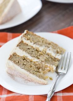 A soft, moist and crumbly apple cider cake with a whipped vanilla malt frosting makes this cake a great fall recipe!