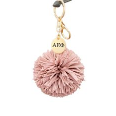 Be Alpha Epsilon Phi's biggest cheerleader with this super cool handmade suede pom tassel keychain. Great gift for a sister or even for yourself! Shop now!