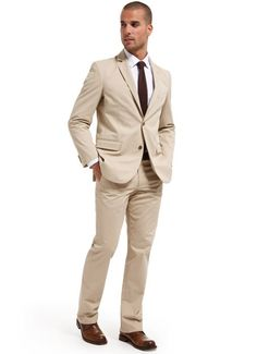Another option. Beige/Khaki suit with dark brown tie. I think it will still tie in well with teal/brown theme. -s.d.