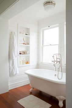 Splashy Shiplap convention Los Angeles Beach Style Bathroom with bathroom bathtub beach bungalow California clapboard clawfoot cottage Craftsman double hung windows pine floor Santa