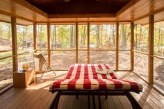 HGTV presents a tiny luxury cabin with yellow pine walls, a screened porch, and 400 square feet of living space. Tiny House Movement, Nachhaltiges Design, House Design, Cabin Design, Design Ideas, Tiny Log Cabins, Small Cabins, Rustic Cabins, Park Model Homes