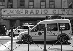 Vintage Radio City Music Hall. Black and white photography by Andrea Rea. Taxis line the street in front of the iconic Radio City Music Hall in New York City in this classic street scene. Original work available as framed print, canvas, and more only on Fine Art America and Pixels.com. https://andrea-rea.pixels.com/