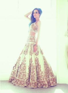 Ekta Solanki Couture | About ES - History. White and gold lehenga #gold #indianbridaldresses