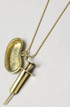 The Syringe Necklace in Brass by Monserat De Lucca Jewelry