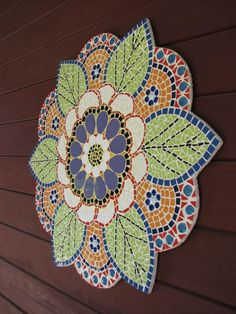 Lovely Tone in color...as well as the beautiful detail in this mosaic art piece.