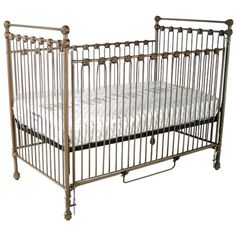 Corsican- Classic Iron Crib Crib meets all safety guidelines and has a one side drop down