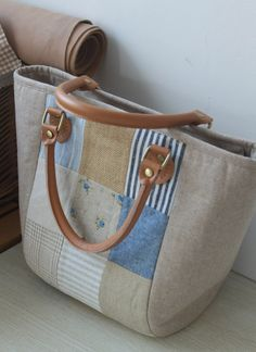 Linen Fabric Bag from Etsy  ....... interesting combinations of fabric, including burlap/hessian which gives a lovely texture