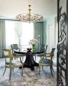 Pretty and luxurious.  Love the custom made ebonized-mahogany table!