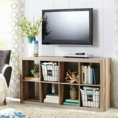 cute storage unit...I like that it's not white, but has a subtle wood grain look to it.