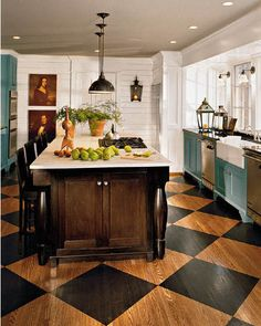 so much to love here. Dark island with white countertop, pendant lights, floor, two-tone cabinetry. Someone has some good taste.