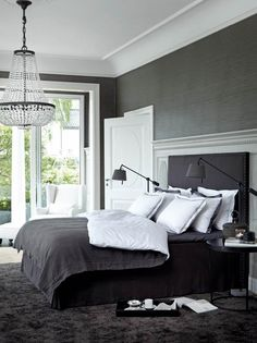 love the glamorous crystal chandelier, dark wall colour and dark and white bedding