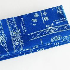 Antique Airplane Blueprints Cotton Napkins (Set of 4) ME2Designs Handmade Table Decor. These handmade antique airplane blueprints cotton napkins would be perfect for anyone with a love of aviation history and aeronautical engineering! The print of this cotton fabric has images in white of actual airplane blueprint designs from the early 1900s overlaid on a background of a shaded blue that looks just like real blueprints did in the last century. These eco friendly napkins would be a great...