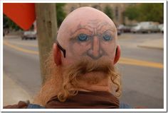 uhm.. look carefully at the BACK of this guy's head tatoo!