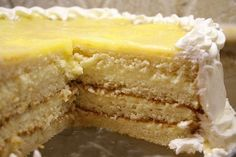 """Here's the perfect dessert for Easter: Lemon Truffle Cake. It's a four-layer white cake with a creamy lemon filling. The """"lemon truffle"""" consists of lemon curd with white chocolate and cream cheese mixed in. It's pretty much to-die-for. Lemon Desserts, Lemon Recipes, Just Desserts, Delicious Desserts, Cake Recipes, Dessert Recipes, Yummy Food, Lemon Truffles, Cake Truffles"""
