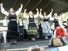 "GRUPO FOLCLÓRICO ""OS AMIGOS DE LONGOS VALES""  - Note the light grey Domingar costume and apron"