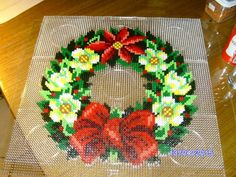 Flower wreath hama perler beads by Anja - Kiids & Friends Perler Bead Designs, Hama Beads Design, Pearler Bead Patterns, Perler Bead Art, Perler Patterns, Pearler Beads, Christmas Perler Beads, Modele Pixel Art, Beaded Banners