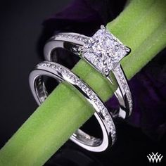 The lower one...that is all I would like for my engagement AND wedding ring. Simple. :) [Platinum Channel Set Engagemen