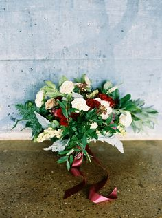 bouquet tied with burgundy ribbon - photo by Jessica Gold Photography http://ruffledblog.com/dusty-blue-and-cranberry-wedding-inspiration