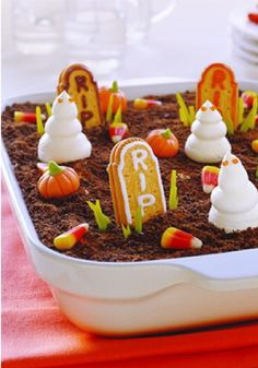 Ghosts in the Graveyard -- No need to fear this graveyard: It's made with chocolate pudding and crushed cookies! See it all come together in this super-quick video.