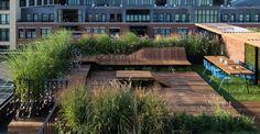 Custom wooden deck for a urban rooftop garden