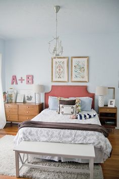 Like this bedroom.  I would do different colors and patterns, but I like the headboard, two big frames, and cute lamps!