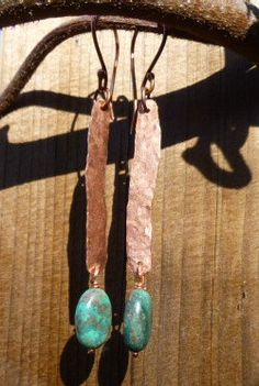 Handcrafted hammered copper earrings with a genuine turquoise drop. Earrings measure just a smidge over 3 inches from top of the ear wire to bottom of turquoise dangle. Each earring is hand forged by myself. My favorite thing about these earrings is how they change in the light.