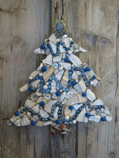 Blue and white mosaic Christmas tree with vintage brooch, mosaic art.