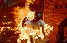 Best photos of 2017 - December 30, 2017:  A demonstrator catches fire during clashes with riot police within a protest against Venezuelan President Nicolas Maduro, in Caracas on May 3, 2017.