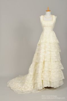1960 Empire Lace Vintage Wedding Gown- I would like it with sleeves and a higher neckline.