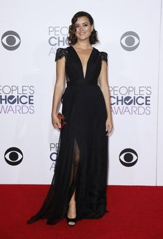 Actress Cote de Pablo arrives in a Black Cap Sleeve Gown at the 2015 People's Choice Awards in Los Angeles, California January 7, 2015.